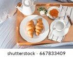 breakfast in bed  a tray of... | Shutterstock . vector #667833409