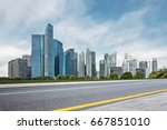 empty road with modern... | Shutterstock . vector #667851010
