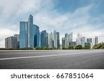 empty road with modern... | Shutterstock . vector #667851064