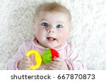 little baby girl in pink shirt... | Shutterstock . vector #667870873