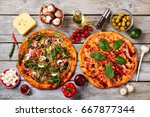 two pizzas and ingredients.... | Shutterstock . vector #667877344