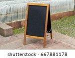 blank black menu stand on... | Shutterstock . vector #667881178