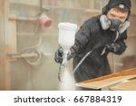 man in respirator mask painting ...   Shutterstock . vector #667884319