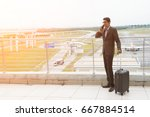 indian male walking at airport   | Shutterstock . vector #667884514