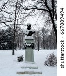 Snow Covered  Statue In A Park...