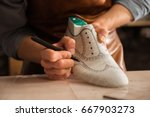 close up of a male shoemaker... | Shutterstock . vector #667903273