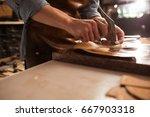 close up of a shoemaker man... | Shutterstock . vector #667903318