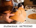 close up of a bootmaker working ... | Shutterstock . vector #667903360