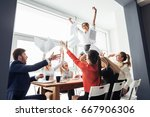 picture of happy business team... | Shutterstock . vector #667906306