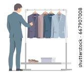 businessman in suit near rack...   Shutterstock .eps vector #667907008