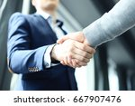 business people shaking hands ... | Shutterstock . vector #667907476