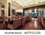 interior of hotel restaurant. | Shutterstock . vector #667911130