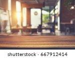 closeup empty wooden table in... | Shutterstock . vector #667912414