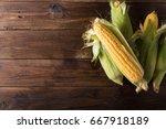 Grains Of Ripe Corn On Wooden...