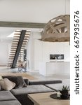 Small photo of Modern spacious living room with white kitchen annex