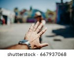 man hand reaching woman in the... | Shutterstock . vector #667937068
