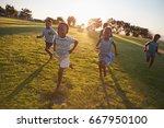 elementary school kids running... | Shutterstock . vector #667950100