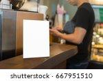 mock up menu frame on table in...   Shutterstock . vector #667951510