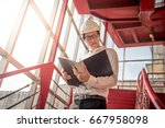 young asian engineer or... | Shutterstock . vector #667958098