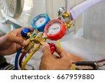 technician vacuum pump... | Shutterstock . vector #667959880