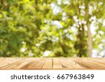 empty top wooden table and...   Shutterstock . vector #667963849
