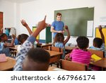 kids raising hands to teacher... | Shutterstock . vector #667966174