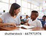 volunteer teacher helping...   Shutterstock . vector #667971976