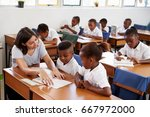 volunteer teacher helping... | Shutterstock . vector #667972000