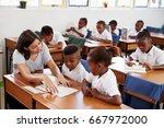 volunteer teacher helping... | Shutterstock . vector #667972000