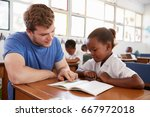 volunteer teacher helping... | Shutterstock . vector #667972018