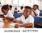 elementary school boy smiling... | Shutterstock . vector #667977994