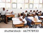 teacher teaching kids from his... | Shutterstock . vector #667978933