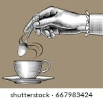 woman's hand with a coffee cup... | Shutterstock . vector #667983424
