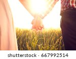young couple holding hands in... | Shutterstock . vector #667992514