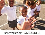 young african schoolgirls in a... | Shutterstock . vector #668003338