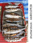 Small photo of whole roasted fish in bbq roster