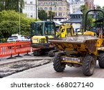 Small photo of Road works, Bournemouth, Dorset, June 2017; workmen re-lay pavement and road in city centre; editorial