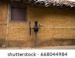 house of wattle and daub. brazil | Shutterstock . vector #668044984