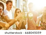 summer party. friends at cafe... | Shutterstock . vector #668045059