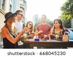 summer party. friends at cafe... | Shutterstock . vector #668045230