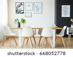 Bright spacious dining room with wooden big table