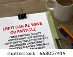 light can be wave or particle   ... | Shutterstock . vector #668057419