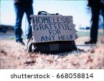 Small photo of Homeless sign