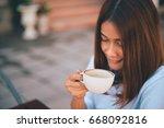 asian woman drinking coffee in... | Shutterstock . vector #668092816