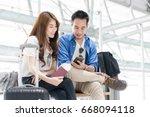 couple asian student traveler... | Shutterstock . vector #668094118