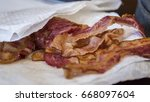 bacon on paper towel | Shutterstock . vector #668097604