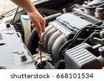 man checking car engine. | Shutterstock . vector #668101534