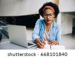 focused young african female... | Shutterstock . vector #668101840