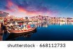 Great spring seascape on Aegean Sea. Colorful evening panorama of Kavala city, the principal seaport of eastern Macedonia and the capital of Kavala regional unit. Greece, Europe.