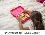 preparing lunch for child... | Shutterstock . vector #668122594